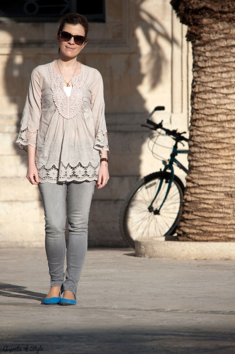 grey silk blouse, grey jeans